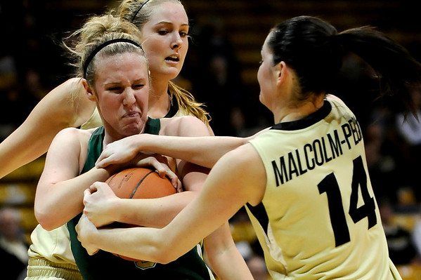 Colorado's Meagan Malcolm-Peck (right) and Colorado State's Hayley Thompson (left) fight for the ball during their game at the University of Colorado in Boulder, Colorado December 8, 2010.  CAMERA/Mark Leffingwell