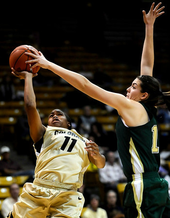 Colorado's Brittany Wilson (left) gets blocked by Colorado State's Sam Martin (right) during their game at the University of Colorado in Boulder, Colorado December 8, 2010.  CAMERA/Mark Leffingwell