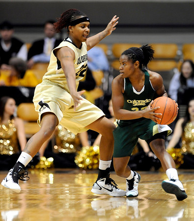 Colorado's Brittany Spears (left) guards Colorado State's Meixandra Porter (left) during their game at the University of Colorado in Boulder, Colorado December 8, 2010.  CAMERA/Mark Leffingwell