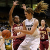 Colorado's Rachel Hargis (right) losses control of the ball while being guarded by Denver University's Maiya Michel (left) during their basketball game at the University of Colorado in Boulder, Colorado December 8, 2011. CAMERA/MARK LEFFINGWELL