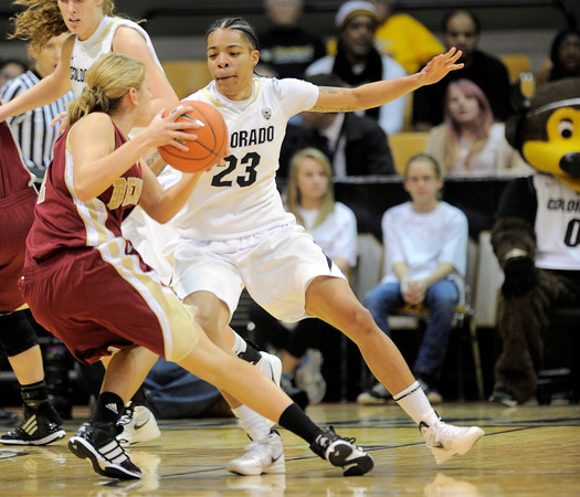 Colorado's Chucky Jeffery (right) guards Denver University's Quincey Noonan (left) during their basketball game at the University of Colorado in Boulder, Colorado December 8, 2011. CAMERA/MARK LEFFINGWELL