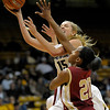 Colorado's Julie Seabrook (left) fights past Denver University's Maiya Michel (right) for a basket during their basketball game at the University of Colorado in Boulder, Colorado December 8, 2011. CAMERA/MARK LEFFINGWELL