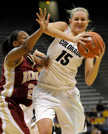 Colorado's Julie Seabrook (right) fights her way toward the basket while being guarded by Denver University's Maiya Michel (left) during their basketball game at the University of Colorado in Boulder, Colorado December 8, 2011. CAMERA/MARK LEFFINGWELL