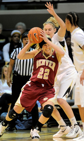 Colorado's Jen Reese (right) pressured Denver University's Morgan Shell (left) during their basketball game at the University of Colorado in Boulder, Colorado December 8, 2011. CAMERA/MARK LEFFINGWELL