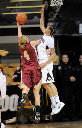 Colorado's Chuck Jeffery (right) blocks a shot from Denver University's Quincey Noonan (left) during their basketball game at the University of Colorado in Boulder, Colorado December 8, 2011. CAMERA/MARK LEFFINGWELL