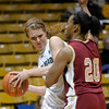Colorado's Rachel Hargis (left) is pressured by Denver University's Maiya Michel (right) during their basketball game at the University of Colorado in Boulder, Colorado December 8, 2011. CAMERA/MARK LEFFINGWELL