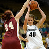 Colorado's Rachel Hargis (right) is blocked by Denver University''s Kaetlyn Murdoch (left) during their basketball game at the University of Colorado in Boulder, Colorado December 8, 2011. CAMERA/MARK LEFFINGWELL