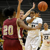Colorado's Brittany Wilson (right) passes the ball off while being guarded by Denver University's Quincey Noonan (center) and Maiya Michel (left) during their basketball game at the University of Colorado in Boulder, Colorado December 8, 2011. CAMERA/MARK LEFFINGWELL
