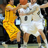 Wyoming's Luke Martinez (left) passes the ball while being guarded by Colorado's Nate Tomlinson (right) during their basketball game at the University of Colorado in Boulder, Colorado December 9, 2011. CAMERA/MARK LEFFINGWELL