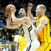 Colorado's Austin Dufault (left) looks to shoot while being guarded by Wyoming's Adam Waddell (right) during their basketball game at the University of Colorado in Boulder, Colorado December 9, 2011. CAMERA/MARK LEFFINGWELL