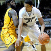 Colorado's Andre Roberson (right) is guarded by Wyoming's Leonard Washington (left) during their basketball game at the University of Colorado in Boulder, Colorado December 9, 2011. CAMERA/MARK LEFFINGWELL