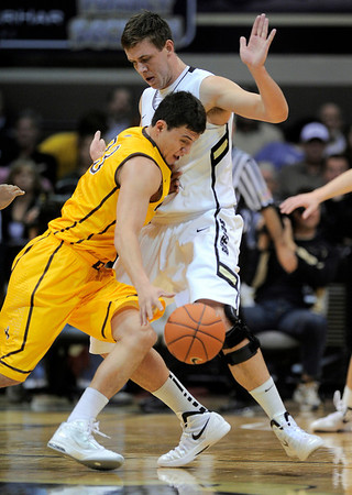 Wyoming's Francisco Cruz (left) collides with Colorado's Shane Harris-Tunks (right) during their basketball game at the University of Colorado in Boulder, Colorado December 9, 2011. CAMERA/MARK LEFFINGWELL