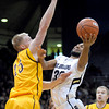 Colorado's Carlon Brown (right) is fouled by Wyoming's Adam Waddell (left) during their basketball game at the University of Colorado in Boulder, Colorado December 9, 2011. CAMERA/MARK LEFFINGWELL
