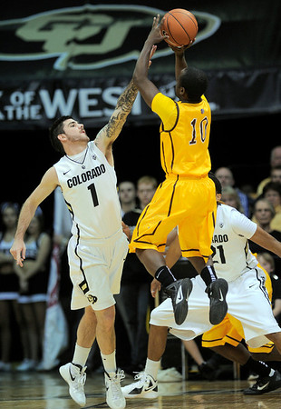 Colorado's Nate Tomlinson (left) tries to block Wyoming's Derrious Gilmore (right) during their basketball game at the University of Colorado in Boulder, Colorado December 9, 2011. CAMERA/MARK LEFFINGWELL