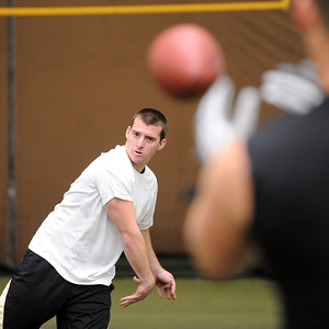Tyler Hansen throws for the pro scouts during timing day. University of Colorado football players showed their skills to NFL scouts on Thursday during CU pro timing day. For a video and more photos of timing day, go to www.dailycamera.com. Cliff Grassmick / March 8, 2012