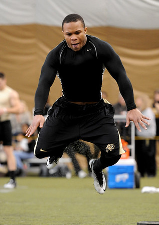 "Rodney Stewart does the long jump for the scouts.<br /> University of Colorado football players showed their skills to NFL scouts on Thursday during CU pro timing day.<br /> For a video and more photos of timing day, go to  <a href=""http://www.dailycamera.com"">http://www.dailycamera.com</a>.<br /> Cliff Grassmick / March 8, 2012"