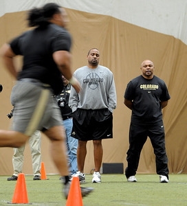 Head coach Jon Embree, and strength coach, Malcolm Blacken, watch Sione Tau run for the scouts.University of Colorado football players showed their skills to NFL scouts on Thursday during CU pro timing day. For a video and more photos of timing day, go to www.dailycamera.com. Cliff Grassmick / March 8, 2012
