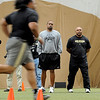 "Head coach Jon Embree, and strength coach, Malcolm Blacken, watch Sione Tau run for the scouts.University of Colorado football players showed their skills to NFL scouts on Thursday during CU pro timing day.<br /> For a video and more photos of timing day, go to  <a href=""http://www.dailycamera.com"">http://www.dailycamera.com</a>.<br /> Cliff Grassmick / March 8, 2012"
