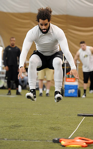 Josh Hartigan does the long jump for the scouts. University of Colorado football players showed their skills to NFL scouts on Thursday during CU pro timing day. For a video and more photos of timing day, go to www.dailycamera.com. Cliff Grassmick / March 8, 2012