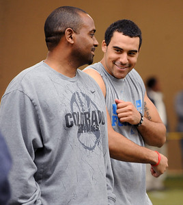 CU football coach, Jon Embree, jokes with his son, Taylor, during timing day in Boulder. University of Colorado football players showed their skills to NFL scouts on Thursday during CU pro timing day. For a video and more photos of timing day, go to www.dailycamera.com. Cliff Grassmick / March 8, 2012