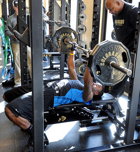 Toney Clemons bench presses for the scouts. University of Colorado football players showed their skills to NFL scouts on Thursday during CU pro timing day. For a video and more photos of timing day, go to www.dailycamera.com. Cliff Grassmick / March 8, 2012