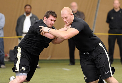 Ethan Adkins, left, and Ryan Miller, workout for the pro scouts. University of Colorado football players showed their skills to NFL scouts on Thursday during CU pro timing day. For a video and more photos of timing day, go to www.dailycamera.com. Cliff Grassmick / March 8, 2012