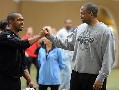 CU football coach, Jon Embree, congratulates Anthony Perkins after his workout for the pros. University of Colorado football players showed their skills to NFL scouts on Thursday during CU pro timing day. For a video and more photos of timing day, go to www.dailycamera.com. Cliff Grassmick / March 8, 2012