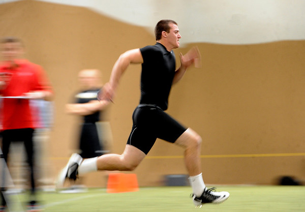 "Tyler Hansen runs a 40-yard dash for the pro scouts.<br /> University of Colorado football players showed their skills to NFL scouts on Thursday during CU pro timing day.<br /> For a video and more photos of timing day, go to  <a href=""http://www.dailycamera.com"">http://www.dailycamera.com</a>.<br /> Cliff Grassmick / March 8, 2012"