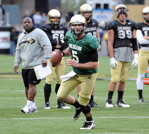 """CU QB  Connor Wood looks for the open man during the Spring scrimmage.<br /> For more photos of the game, go to  <a href=""""http://www.dailycamera.com"""">http://www.dailycamera.com</a><br /> Cliff Grassmick / April 14, 2012"""