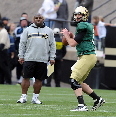 """Eric Bieniemy and Connor Wood during the Spring game.<br /> For more photos of the game, go to  <a href=""""http://www.dailycamera.com"""">http://www.dailycamera.com</a><br /> Cliff Grassmick / April 14, 2012"""