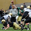 "Connor Wood gets off a pass under pressure in the Spring game on Saturday.<br /> For more photos of the game, go to  <a href=""http://www.dailycamera.com"">http://www.dailycamera.com</a><br /> Cliff Grassmick / April 14, 2012"