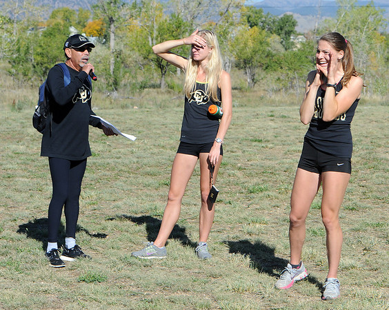 "Rich Castro, left, gets help from CU Olympians, Emma Coburn and Shalaya Kip on Saturday.<br /> For more photos of the race, got to  <a href=""http://www.dailycamera.com"">http://www.dailycamera.com</a>.<br /> Cliff Grassmick  / September 29, 2012"
