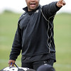 "Eric Bieniemy coaches the running backs on Sunday.<br /> For  more photos and a video of Embree, go to  <a href=""http://www.dailycamera.com"">http://www.dailycamera.com</a>.<br /> Cliff Grassmick / March 11, 2012"