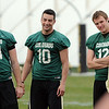 "John Schrock, left, Isaac Archuleta, Stevie Joe Dorman, and coach Rip Scherer in a QB cluster.<br /> For  more photos and a video of Embree, go to  <a href=""http://www.dailycamera.com"">http://www.dailycamera.com</a>.<br /> Cliff Grassmick / March 11, 2012"