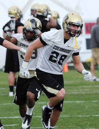 """Will Harlos (28) works out during Spring drills on Sunday.<br /> For  more photos and a video of Embree, go to  <a href=""""http://www.dailycamera.com"""">http://www.dailycamera.com</a>.<br /> Cliff Grassmick / March 11, 2012"""