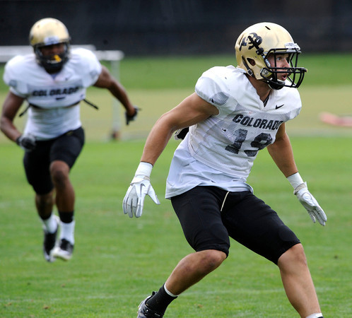 Travis Sandersfeld, 19, in a pass coverage drill during the University of Colorado Football practice on Thursday August 25. <br /> Photo by Paul Aiken / The Camera / August 25 2011