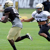Terrel Smith, 41, covers a practice squad member during pass coverage drills during the University of Colorado Football practice on Thursday August 25. <br /> Photo by Paul Aiken / The Camera / August 25 2011