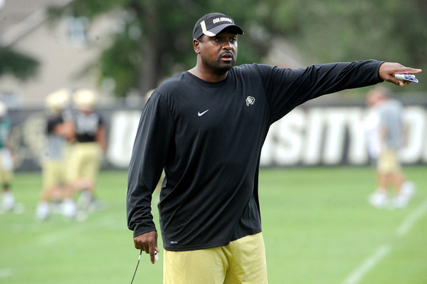 Head Coach Jon Embree questions the secondary about their coverage during the University of Colorado Football practice on Thursday August 25. <br /> Photo by Paul Aiken / The Camera / August 25 2011