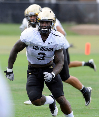 Douglas Rippy, 3, tracks down a receiver during the University of Colorado Football practice on Thursday August 25. <br /> Photo by Paul Aiken / The Camera / August 25 2011