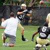 Kyle Cefalo tracks down a pass during the University of Colorado Football practice on Thursday August 25. <br /> Photo by Paul Aiken / The Camera / August 25 2011