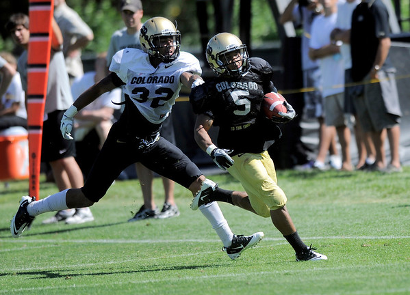 CU's Paul Vigo (left) catches CU's Rodney Stewart (right)  during practice at the University of Colorado in Boulder, Colorado August 9, 2011.   CAMERA/Mark Leffingwell