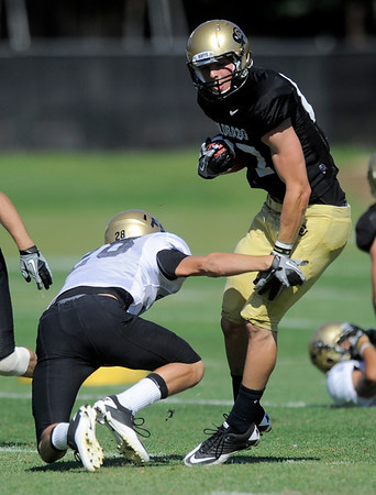 CU's Tyler McCulloch (right) dodges CU's Will Harlos (left) during practice at the University of Colorado in Boulder, Colorado August 9, 2011.   CAMERA/Mark Leffingwell