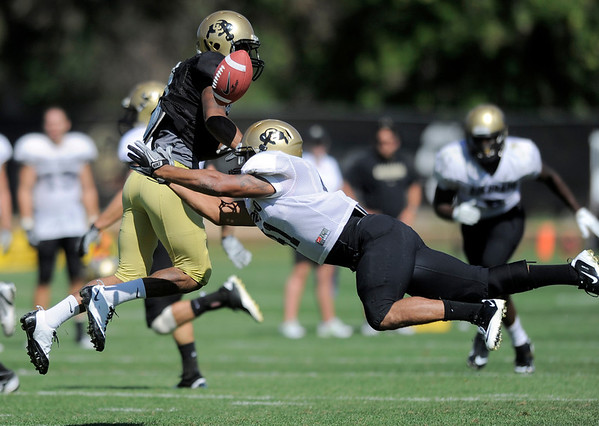 CU's Terrel Smith (right) disrupts a pass to Keenan Canty (left) during practice at the University of Colorado in Boulder, Colorado August 9, 2011.   CAMERA/Mark Leffingwell