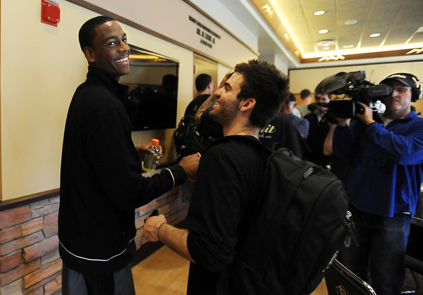 """Alec Burks, left, is congratulated by players and CU basketball staff after his announcement.<br /> University of Colorado basketball player, Alec Burks, announced that he will  leave CU and enter the NBA draft. For more photos and videos of Burks, go to  <a href=""""http://www.dailycamera.com"""">http://www.dailycamera.com</a>.<br /> Cliff Grassmick/ April 21, 2011"""