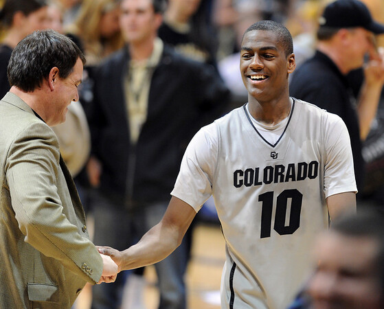 "Colorado Texas Men306.JPG CU AD, Mike Bohn, congratulates Alec Burks after the Texas win.<br /> For more photos of the game, go to  <a href=""http://www.dailycamera.com"">http://www.dailycamera.com</a><br /> Cliff Grassmick / February 26, 2011"