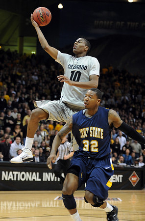 "Colorado Kent State Men116.JPG Alec Burks of CU drives past Rodriquez Sherman of Kent State.<br /> For more photos of the game, go to  <a href=""http://www.dailycamera.com"">http://www.dailycamera.com</a>.<br /> Cliff Grassmick / March 22, 2011"