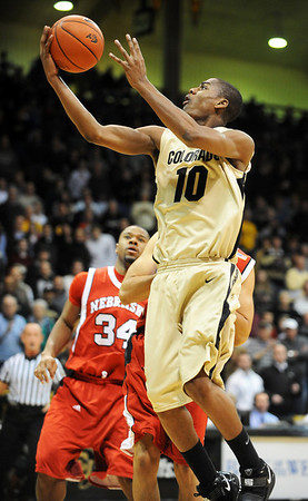 CU Nebraska Men55.JPG Alec Burks of Colorado drives to the basket against Nebraska on Wednesday.<br /> Cliff Grassmick / January 27, 2010