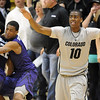 "Colorado Kansas State Men153.JPG Alec Burks, right, of Colorado, waves off an apparent game winner by Rodney McGruder (22) of Kansas State.<br /> For more photos of the CU game, go to  <a href=""http://www.dailycamera.com"">http://www.dailycamera.com</a>.<br /> Cliff Grassmick / February 12, 2011"
