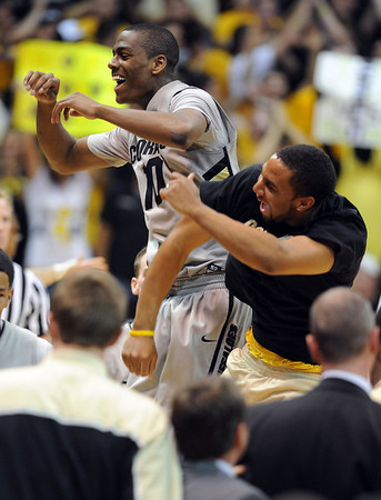 "Colorado Texas Men284.JPG Alec Burks, left, and Carlon Brown of CU, celebrate near the end of the Texas game.<br /> For more photos of the game, go to  <a href=""http://www.dailycamera.com"">http://www.dailycamera.com</a><br /> Cliff Grassmick / February 26, 2011"