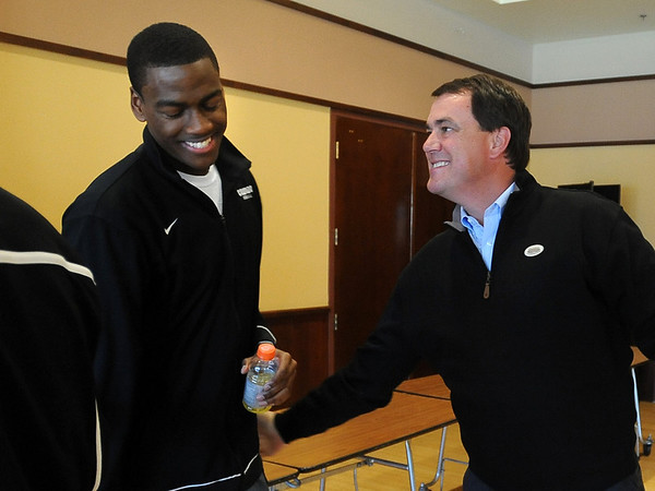 "Alec Burks, left, is congratulated by CU Athletic Director, Mike Bohn after the announcement.<br /> University of Colorado basketball player, Alec Burks, announced that he will  leave CU and enter the NBA draft. For more photos and videos of Burks, go to  <a href=""http://www.dailycamera.com"">http://www.dailycamera.com</a>.<br /> Cliff Grassmick/ April 21, 2011"